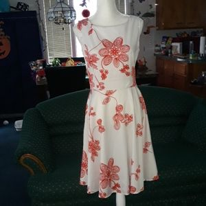 White full skirt dress w swirly accent red flowers